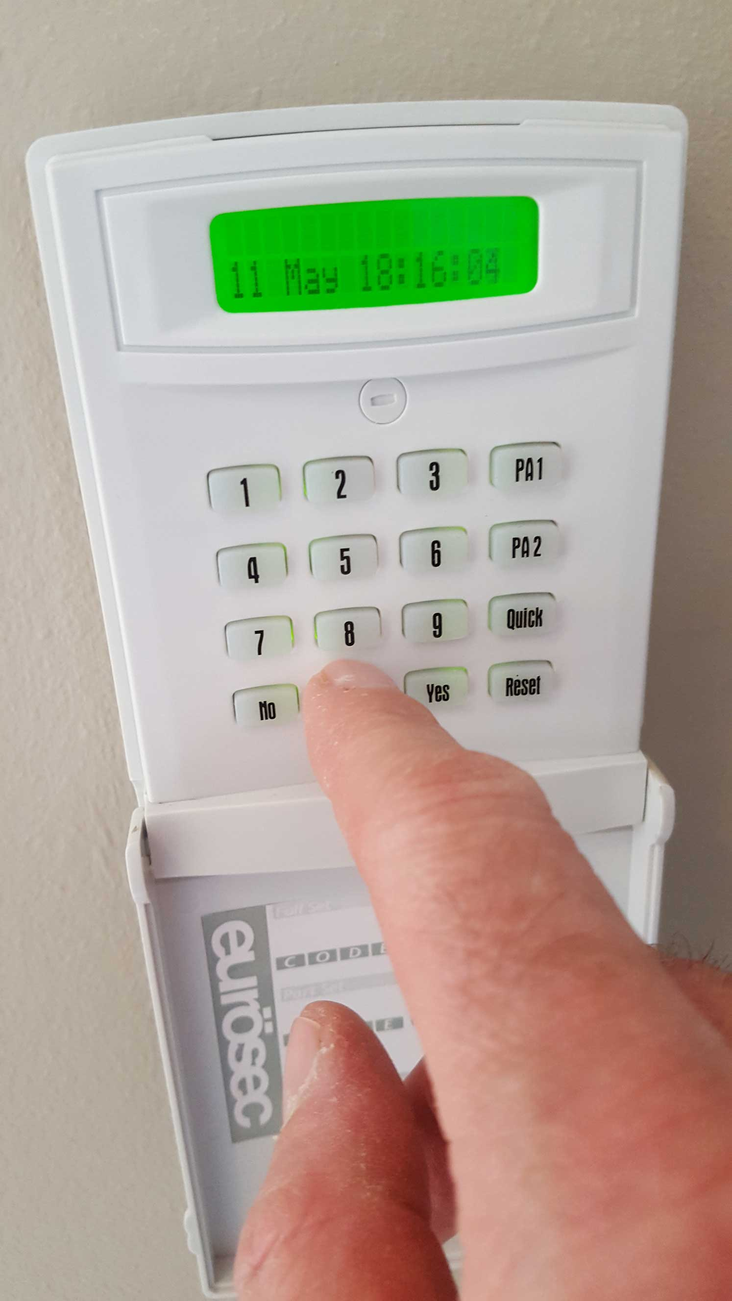 Alarm keypad with user hand